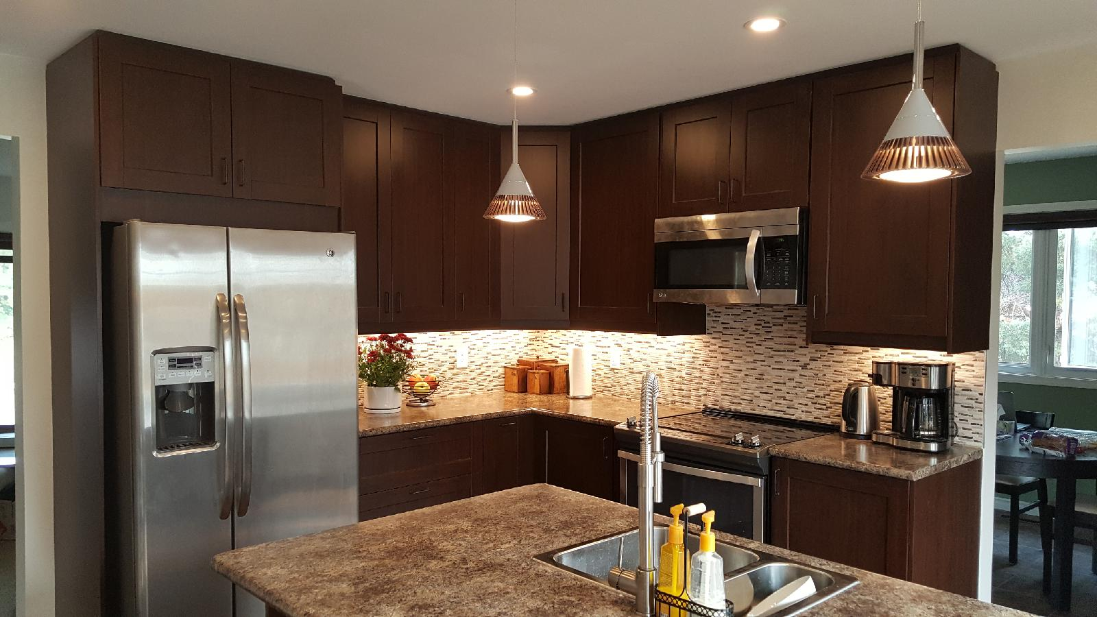 modern kitchen design with dark cabinets and granite style counter tops