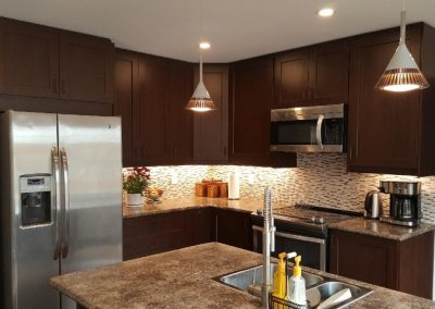 modern kitchen design with dark wooden cabinets and granite style counter tops
