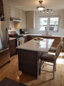 smaller kitchen design with wood panel island counter with two simple bar chairs