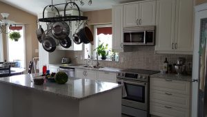 simple kitchen design with white cabinets and gray counter tops