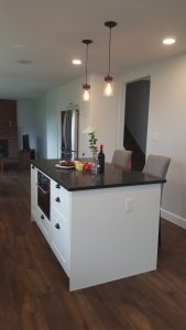 White island kitchen counter with black counter tops