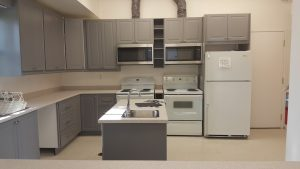 gray kitchen cabinets and simple white counter tops
