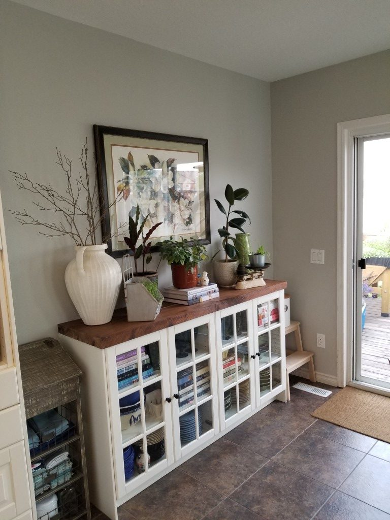 elegant front entrance display with white bookshelf