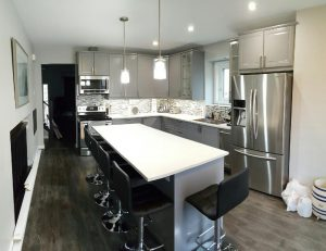 modern style kitchen with leather bar chairs and gray kitchen cabinets