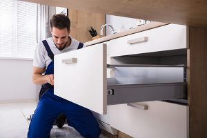 guy installing a cabinet drawer