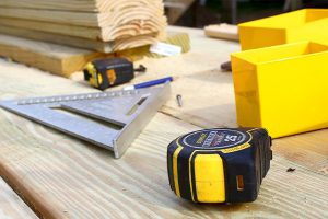 carpentry measuring tape, edge and wooden planks