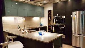 dark wooden kitchen cabinets along with blue-green glass cabinet doors from Ikea