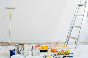 wall painting supplies in a white room