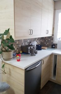 light wooden kitchen cabinets with dishwasher installed